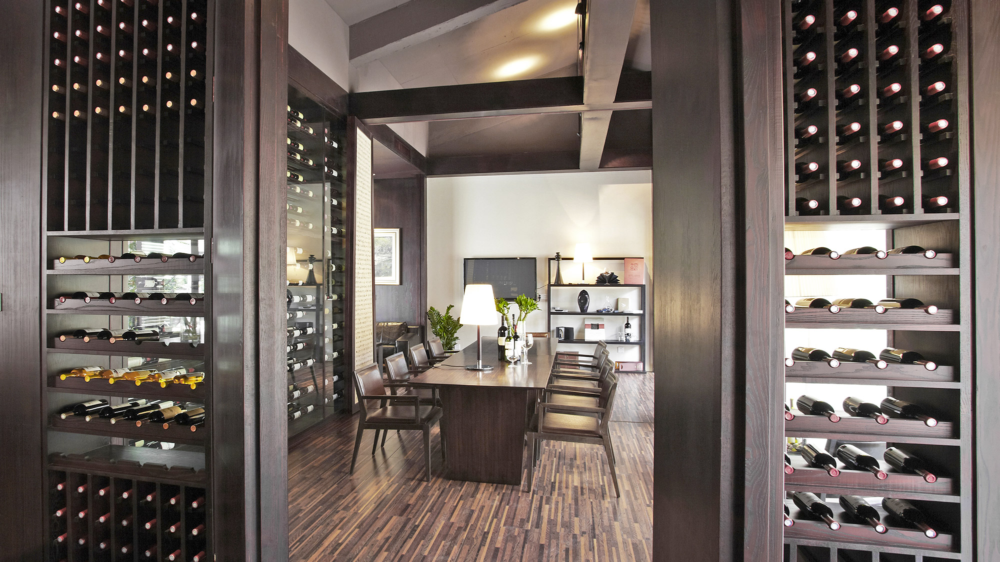 Wine cellar as a function of the dining room.